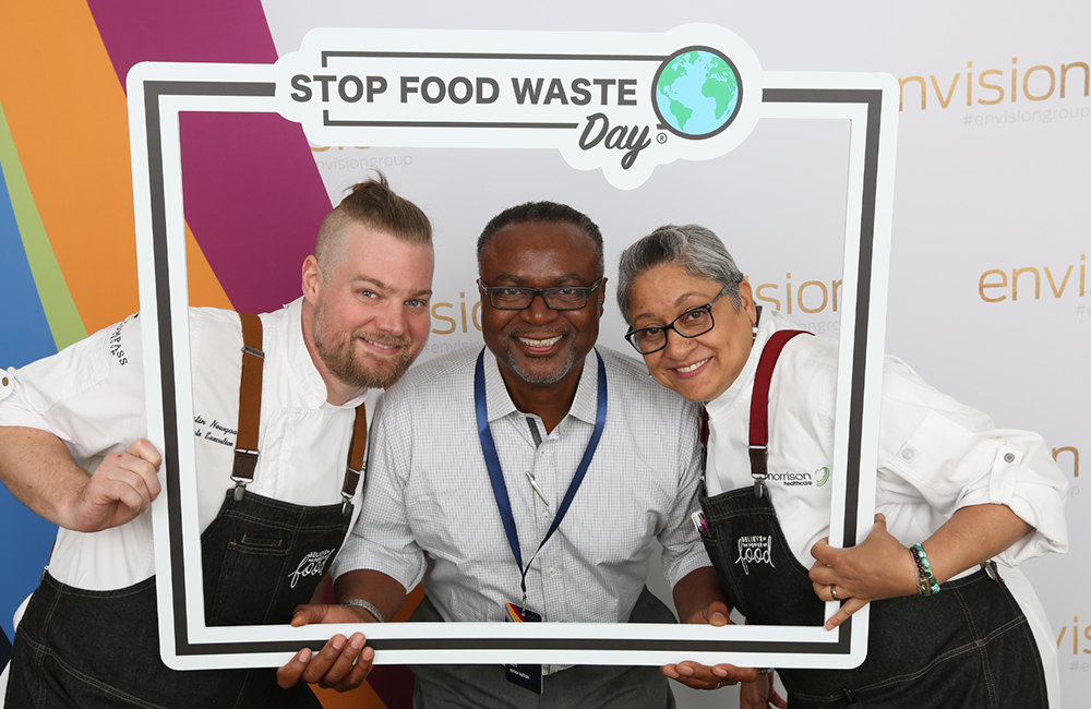 chefs smiling in stop food waste day frame