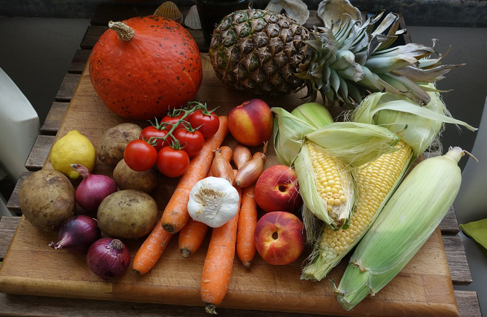 cutting board with fruits and vegetables